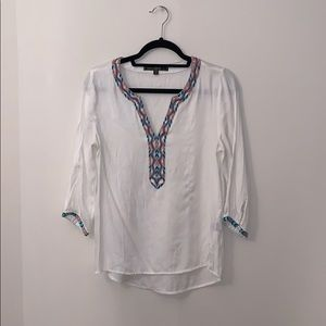 White tunic with blue and orange threading